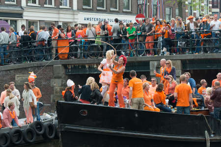 AMSTERDAM - APRIL 26  Fun and dancing  2 during the Celebration of the King's Day on April 26, 2014 in Amsterdam, The Netherlands Editorial