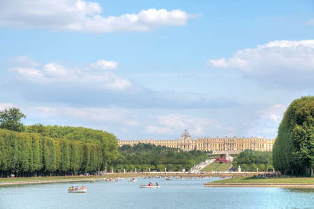 navigate: Versailles, France - July 19th 2015 : navigate on the Grand Canal and Castle in background 3