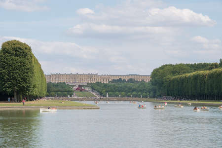 Versailles, France - July 19th 2015 : navigate on the Grand Canal and Castle in background  2
