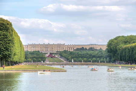 navigate: Versailles, France - July 19th 2015 : navigate on the Grand Canal and Castle in background