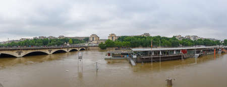 PARIS - JUNE 4: Paris flood with high water on June 4, 2016 in Paris, France. Iena bridge and the parisian Boats Panoramic