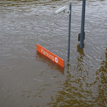 PARIS - JUNE 4: Paris flood with high water on June 4, 2016 in Paris, France. Parking signboard.