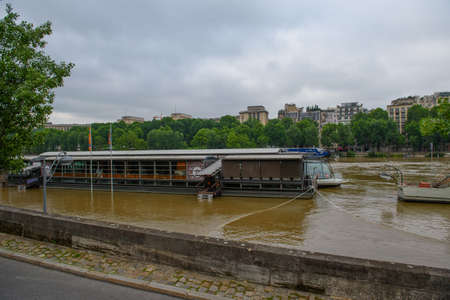 PARIS - JUNE 4: Paris flood with high water on June 4, 2016 in Paris, France. Large view on the Parisian boats Editorial