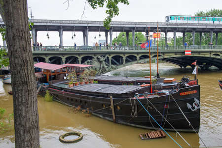 PARIS, FRANCE - JUNE 4: Paris flood with high water on June 4, 2016 in Paris, France. Bir-Hakeim, barge and subway