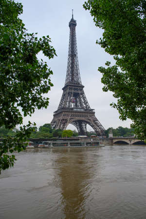 PARIS, FRANCE - JUNE 4: Paris flood with high water on June 4, 2016 in Paris, France. Eiffel Tower Editorial