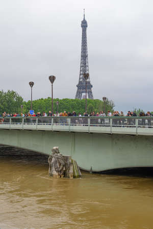 PARIS, FRANCE - JUNE 4: Paris flood with high water on June 4, 2016 in Paris, France.  Zouave of the Alma Bridge and the Eiffel Tower in background