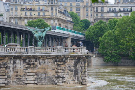 PARIS, FRANCE - JUNE 4: Paris flood with high water on June 4, 2016 in Paris, France. Wedding photography on the Bir-Hakeim bridge during the floods Editorial