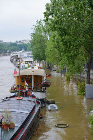 PARIS, FRANCE - JUNE 4: Paris flood with high water on June 4, 2016 in Paris, France. Barges and Quay in the floods Editorial