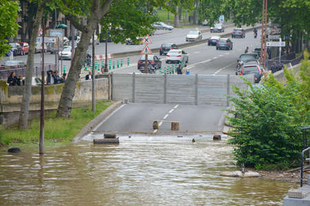 PARIS, FRANCE - JUNE 4: Paris flood with high water on June 4, 2016 in Paris, France. Flooded road.