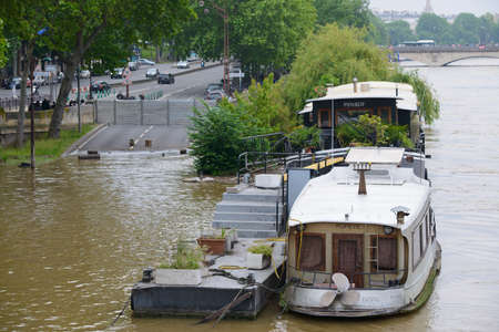 PARIS, FRANCE - JUNE 4: Paris flood with high water on June 4, 2016 in Paris, France. Barge and closed road Editorial