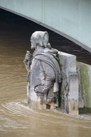 PARIS, FRANCE - JUNE 4: Paris flood with high water on June 4, 2016 in Paris, France. Zouave statue of the Alma bridge into the water Editorial
