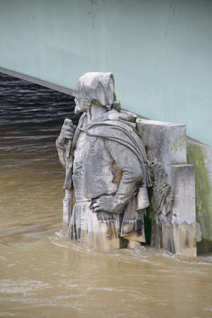 alma: PARIS, FRANCE - JUNE 4: Paris flood with high water on June 4, 2016 in Paris, France. Zouave statue of the Alma bridge into the water Editorial