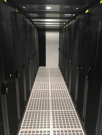 Datacenter : Row of servers racks. Cold Aisle Stock Photo