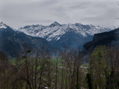 Beautiful Swiss Landscapes with Snow Alps green grass Stock fotó