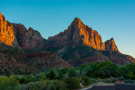 Red Sunset in Zion National Park green and orange colours with blue sky 写真素材 - 123516227