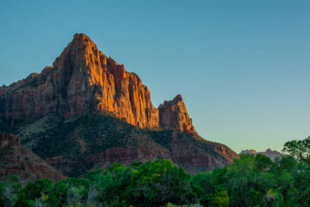 Red Sunset in Zion National Park green and orange colours with blue sky