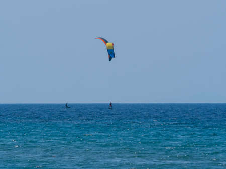 Summer water sports kite surfing wind surfing in clear sea ocean 스톡 콘텐츠