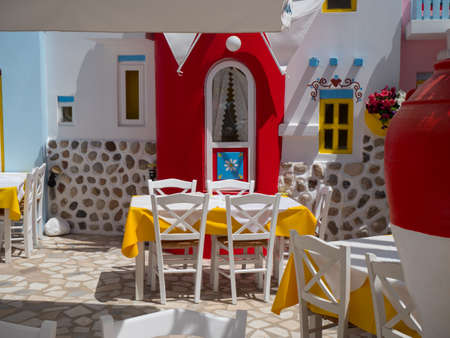 Beautiful greek village streets with flowers decoration