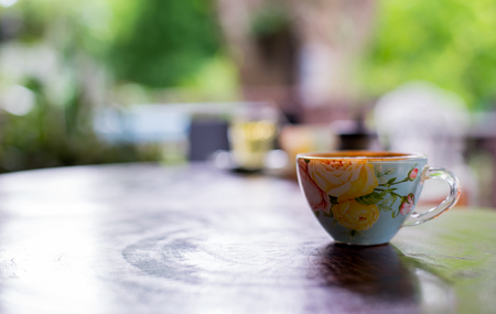 Cup of hot drink with coffee on table. Stock Photo