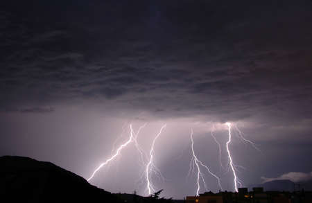 Lightnings in a dark thunderous night Stock Photo - 4810037