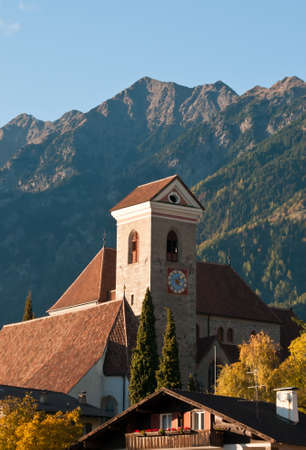meran: Church and bell tower of Scena   Schenna village in Italy