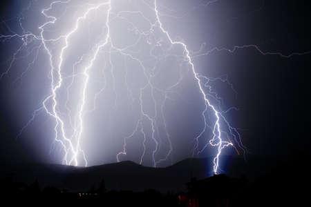 lightnings: Thunderstorm with lightnings in a dark thunderous night