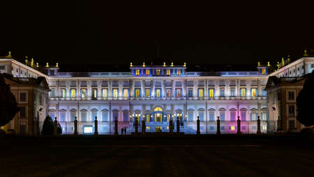 monza: Monza - colorful villa Reale at night with dark sky Editorial