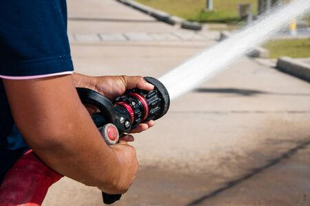 water spray: Firefighters spray water