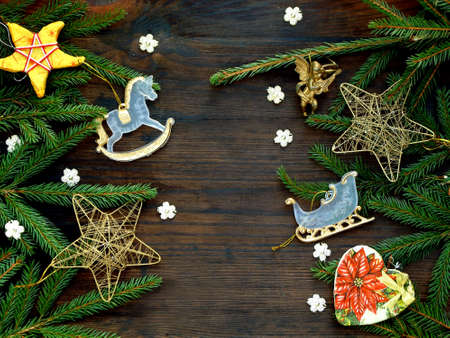 papiermache: New Year and Christmas background. Greeting card with xmas ornaments, conifer branches. Winter holidays concept. Space for text.