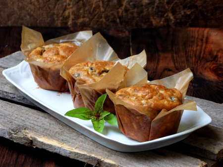 savory snack salted cheese muffins with basil and mushroom. homemade baking
