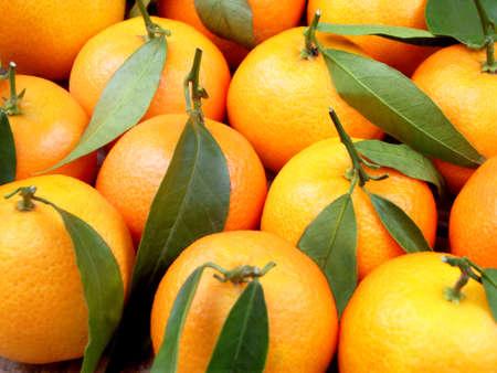 tangerine: ripe juicy tangerine. background fruit