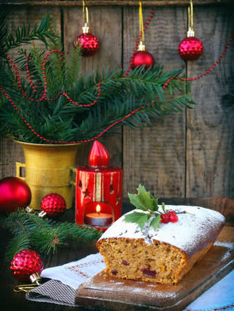 stock photo traditional christmas fruit cake decorated with powdered sugar and xmas decorations candle copy space style rustic - Christmas Fruit Cake Decoration
