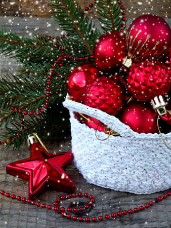 stock photo white crochet round basket with red christmas decorations on wooden background new year and xmas card background copy space selective focus - Christmas Basket Decorations