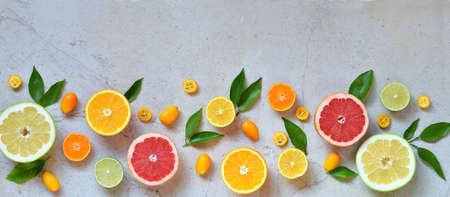 Set of citrus on light background: orange, mandarin, lemon, grapefruit, lime, kumquat, tangerine. Fresh organic juicy fruit. Source of vitamin C. Healthy food concept Copy space