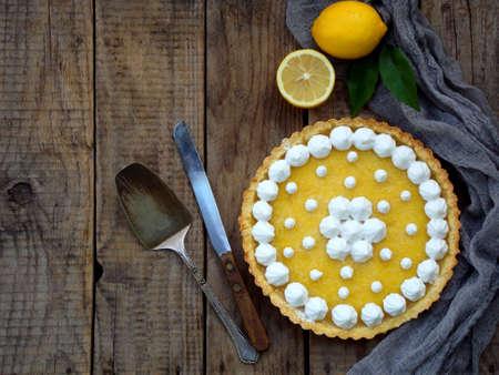 Lemon tart pie with meringue cream. Traditional American cake. Homemade baking. Copy space.