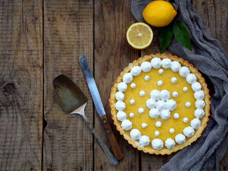 Lemon tart pie with meringue cream. Traditional American cake. Homemade baking. Copy space.