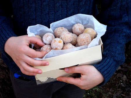 Doughnut. Oat donuts with cinnamon, powdered sugar and coffee. Street food. Round fritter. Space for text. Фото со стока