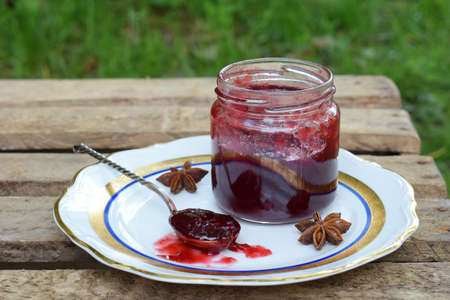 Plum jam with star anise and cinnamon. Fruit marmalade. Autumn canning and preserving. Conservation of harvest. Organic healthy vegetarian food