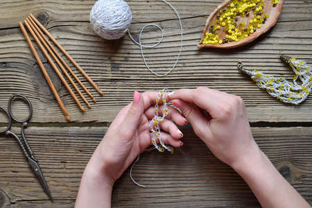 Making the crochet bracelet with beads. Needlework accessories for creating crocheted jewelry. Step 2 - assemble bracelet or chain and attach the clasp. DIY project. Small business. Income from hobby.