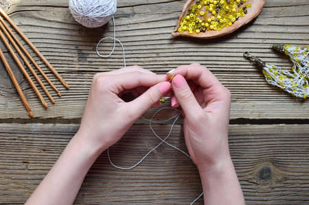 Making the crochet bracelet with beads. Needlework accessories for creating crocheted jewelry. Step 1 - crochet strap for bracelet or chain. DIY project. Small business. Income from hobby.
