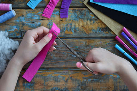 Making the pink lama. Sewing toys from felt with your own hands. DIY concept for children. Handmade crafts. Step 2. Cut all details of toy.