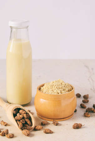 Ð¡hufa milk and tigernut flour. Alternative type of milks. Vegan non-dairy milk. Lactose-Free Milk and Nondairy Beverages. Lactose intolerance. Gluten free. Grain free. Healthy food. Superfood. 免版税图像