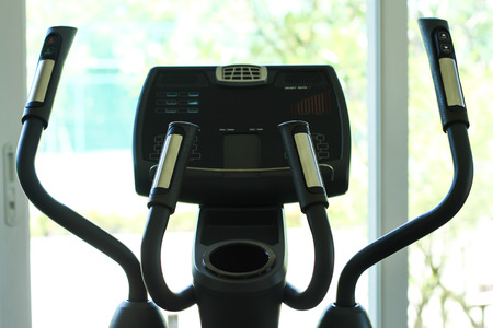 cross trainer in row with a garden viwe. photo
