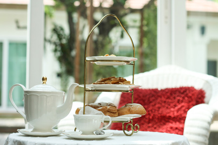 afternoon fancy cake: Tea time in glass house with Eclair and biscuit