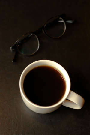 Glasses and coffee cup in the morning photo