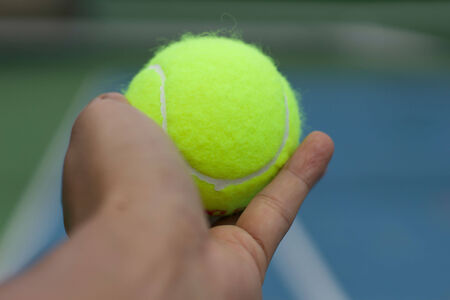 serv: hand hole tennis ball ready to serv