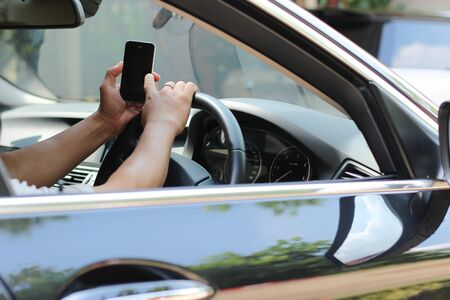 celphone: Man using celphone while driving the a car