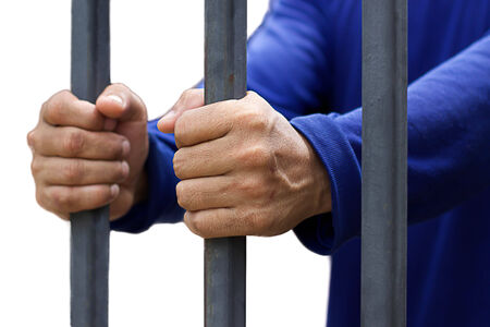 waiting convict: Men Prisonner hand holding a metal bars Stock Photo