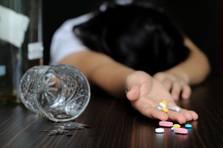Women on pills or  Drugs and Alcohol 스톡 콘텐츠