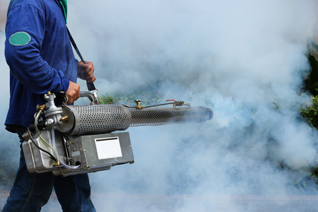 disease control: Man Fogging to prevent spread of dengue fever in thailand